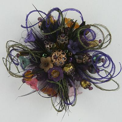 bague plumes violet émeraude orange